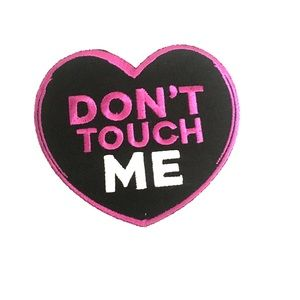 "A ""Don't touch me"" iron on patch."